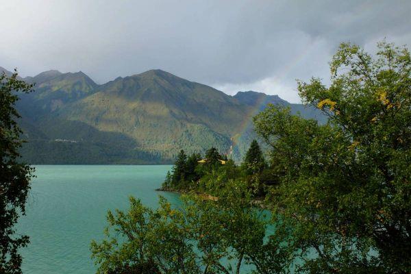 Tibet Basumtso Lake with Rainbow