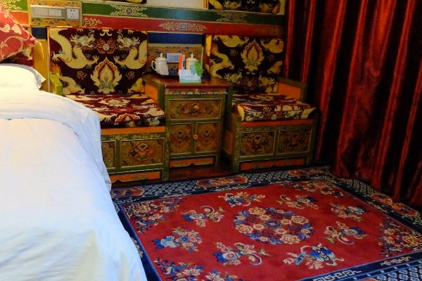 Tibet Guesthouse room with carpet