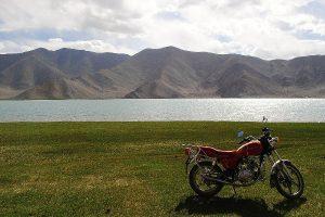 Motorcycle at mountain lake