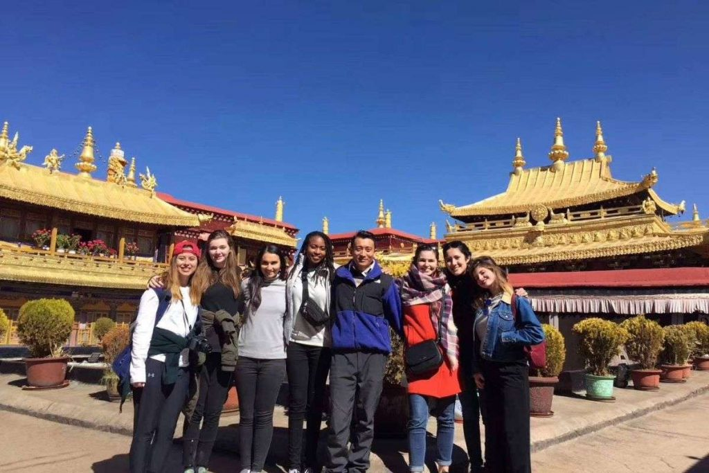 Massive Jokhang Temple Behind the tourist group